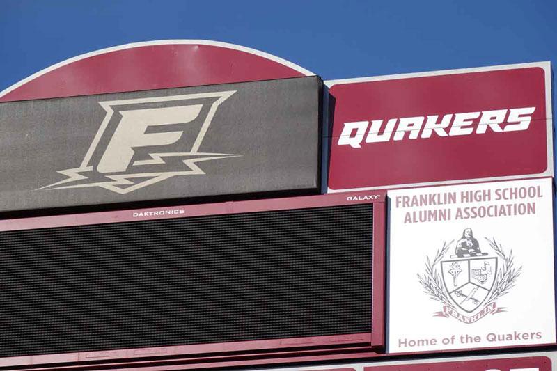 Franklin High Alumni sign on scoreboard donated by Franklin High Alumni