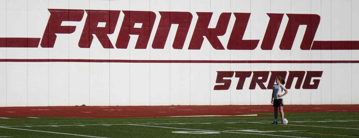 Franklin Strong sign and female soccer player at high school