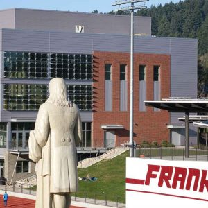 Back of Benjamin Franklin statue with new FHS building in background