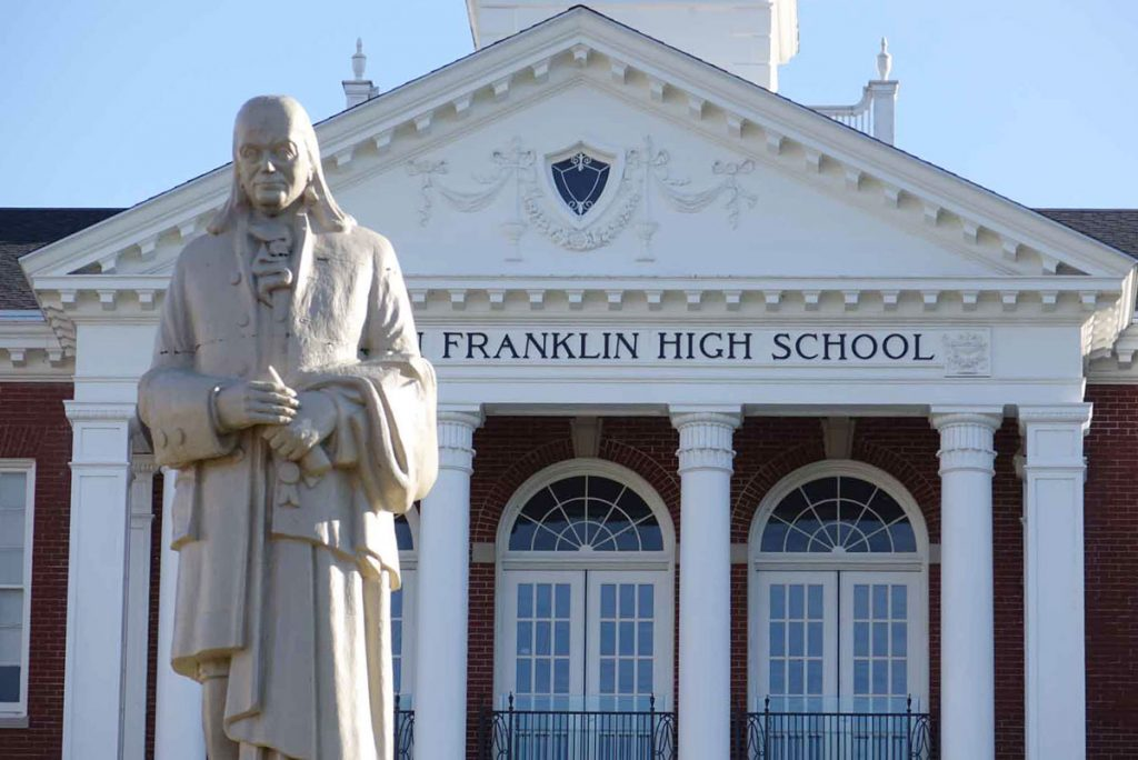 Main entrance to Franklin HS and statue of Benjamin Franklin